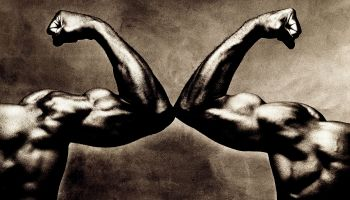 Two male arms, flexing biceps, close-up (toned B&W)