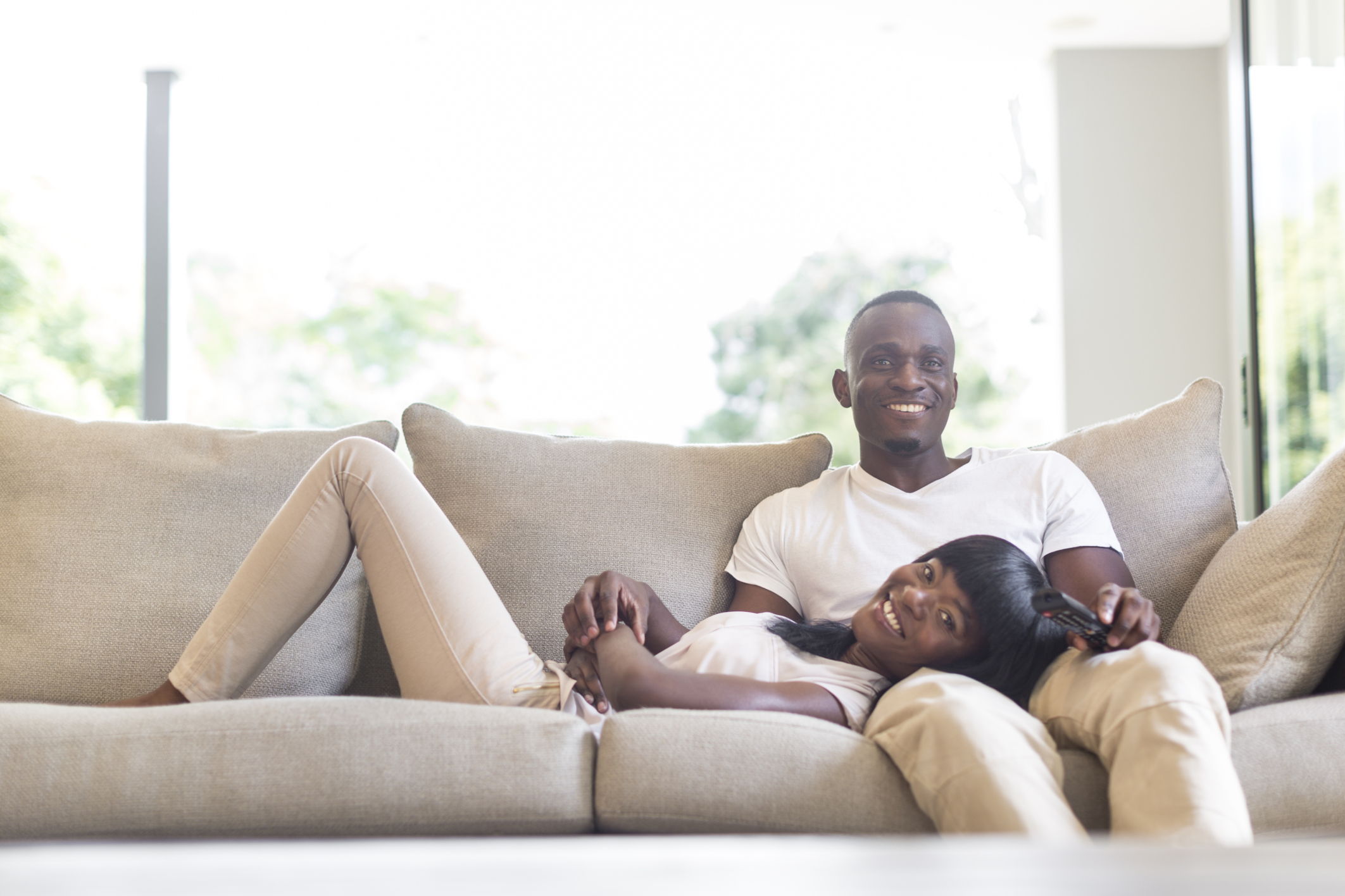 Portrait of couple relaxing on bed, Cape Town, South Africa