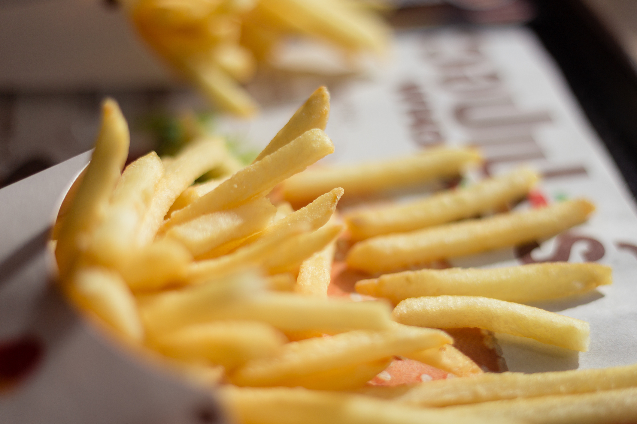 Close-Up Of French Fries In Containers On Table